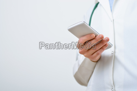 a female doctor texting on smartphone