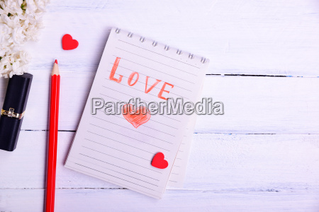 paper notepad with an inscription love