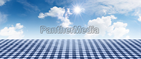 blue checkered tablecloth with summer sky