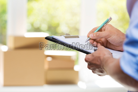 logistics delivery service man writing