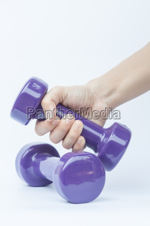 woman hand holding dumbbell weight isolated