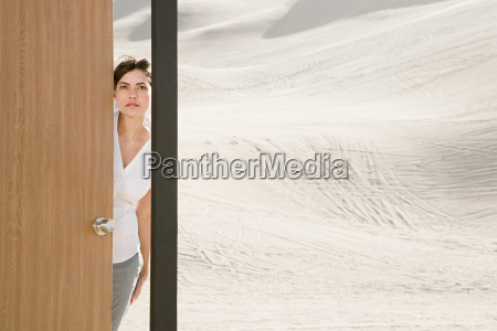 woman opening door in desert