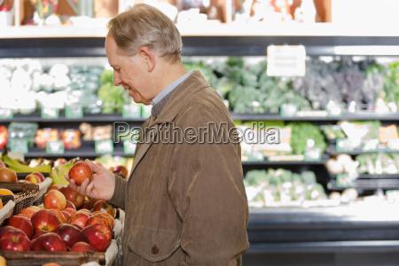 man holding an apple