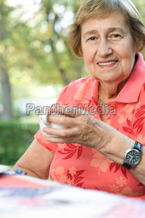 senior adult woman drinking tea