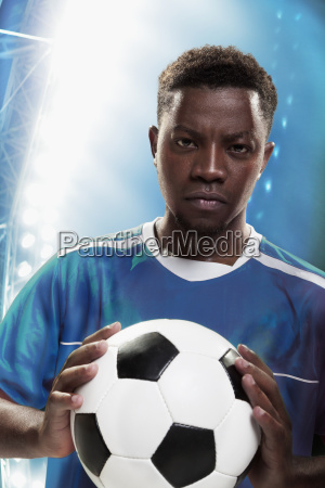 athlete, with, soccer, ball - 21998739