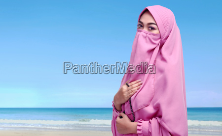 portrait of asian muslim woman with