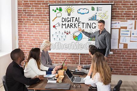 mature businessman giving digital marketing presentation