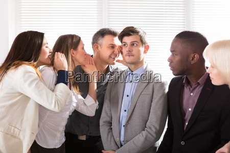 business colleagues whispering in the office