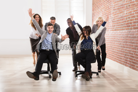 businesspeople making fun in the office