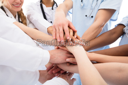 group of doctors stacking their hands