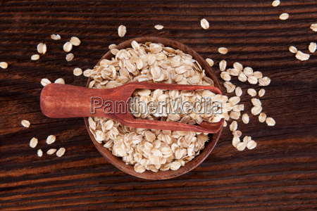 oatmeal flakes on wooden table