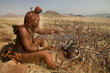himba woman harvesting resin from perfume