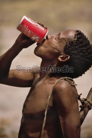 bushman drinking coca cola tsodilo hills