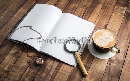 book magnifier clock coffee