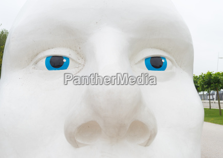 white head with blue eyes