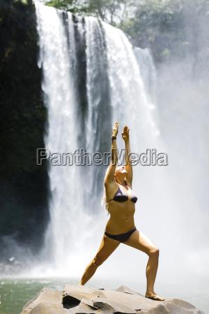 usa hawaii kauai woman practicing yoga