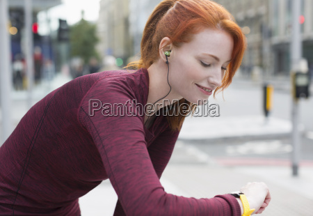 smiling female runner with red hair
