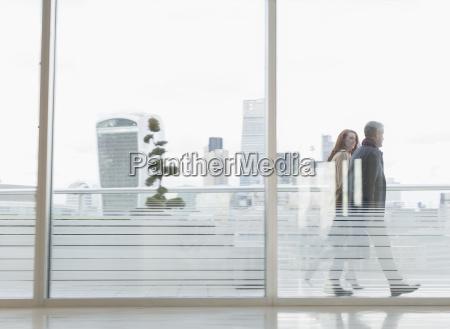 businessman and businesswoman walking on urban