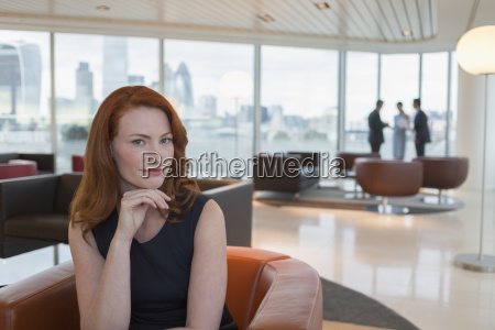 portrait confident businesswoman with red hair
