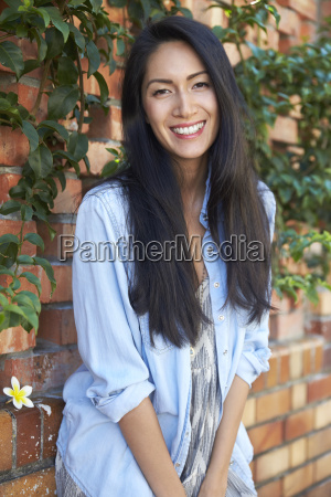 mixed race asian woman looks to