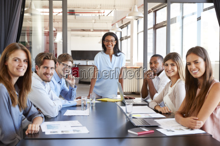 young black woman and seated team