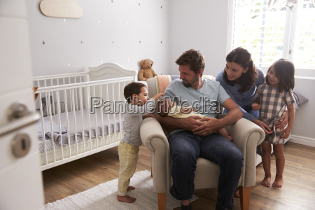 family with children and newborn son