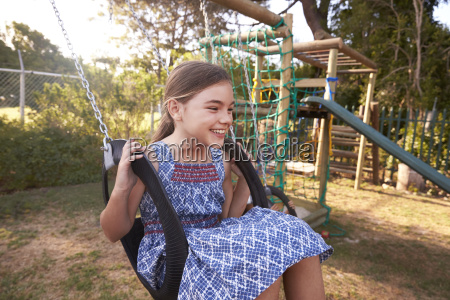 girl playing outdoors at home on