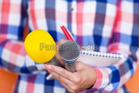 reporter news conference press interview microphone