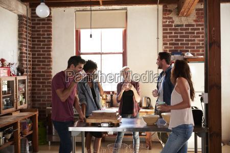 five friends having coffee in kitchen