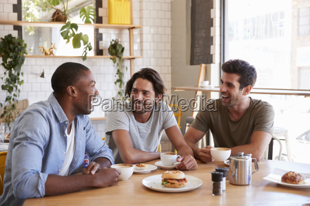 three male friends meeting for lunch