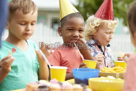 children enjoying outdoor birthday party together