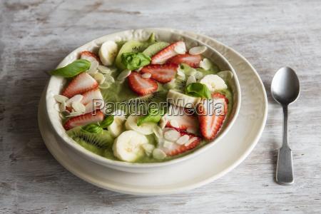 smoothie bowl with strawberries banana kiwi