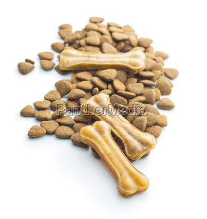 dog chew bone and dry kibble