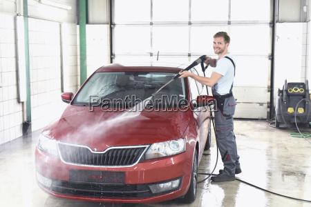 man cleaning car at car wash