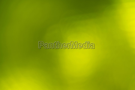 green abstract blur background with lens