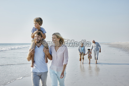 happy extended family strolling on the