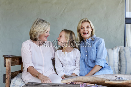 little girl sitting together with grandmother