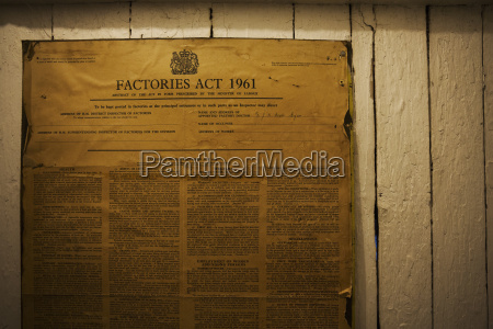 yellowed poster of the factories act
