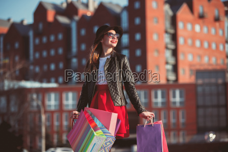 the girl walking with shopping on