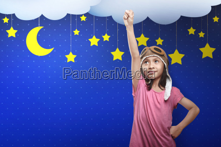 asian child in astronaut costume dreaming
