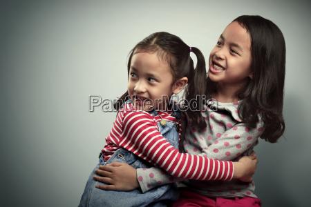 portrait of two asian little kids