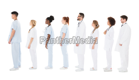 multiracial medical team standing on row