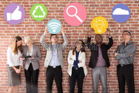 businesspeople with business symbols