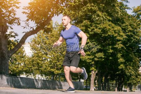 man running in park at morning