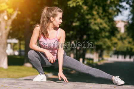 fit fitness woman doing stretching exercises