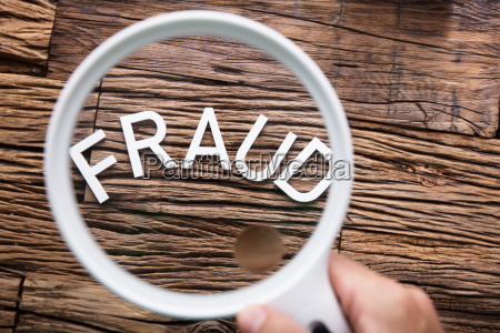 fraud text through magnifying glass