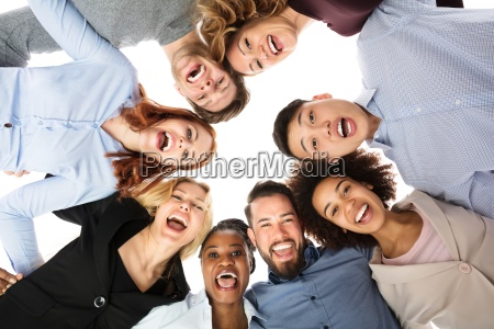 happy multiracial college students forming huddle