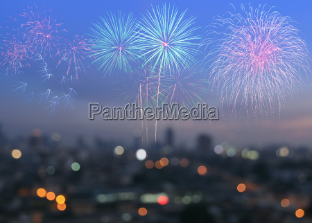 colorful fireworks on blur city skyline