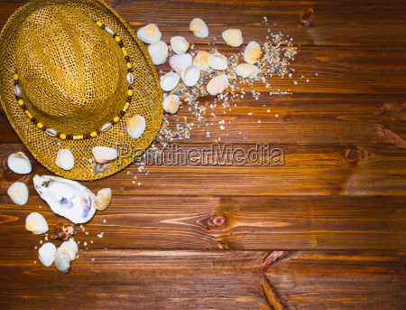 sand hat and shells on the