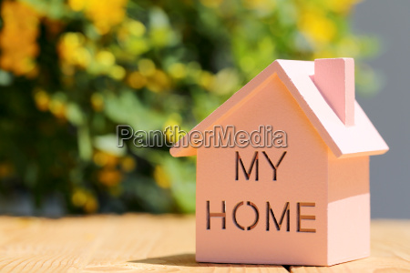 wooden toy house with beautiful blossom